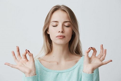 Combine Face Yoga With CBD Oil To Look And Feel Younger
